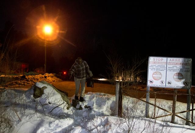A man who claimed to be from Sudan who kept saying ''I just want to be safe'' illegally crosses the U.S.-Canada border leading into Hemmingford, Quebec, Canada, March 20, 2017. REUTERS/Christinne Muschi