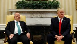 U.S. President Donald Trump meets with Iraqi Prime Minister Haider al-Abadi at the White House in Washington, U.S., March 20, 2017.   REUTERS/Kevin Lamarque