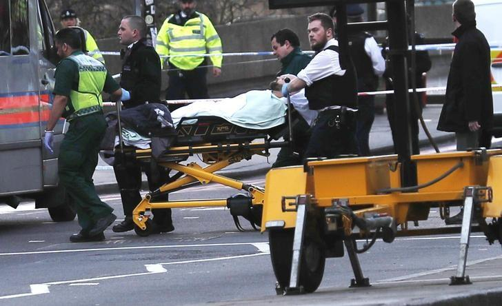 Members of the emergency services take an injured person away on a stretcher after an incident on Westminster Bridge in London, Britain March 22, 2017. REUTERS/Eddie Keogh