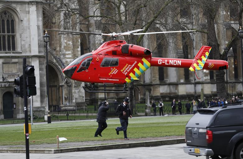An air ambulance lands in Parliament Square during an incident on Westminster Bridge. REUTERS/Stefan Wermuth