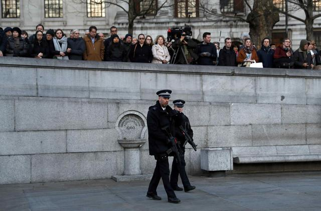 Armed police officers patrol at a vigil in Trafalgar Square the day after an attack, in London, Britain March 23, 2017.    REUTERS/Darren Staples