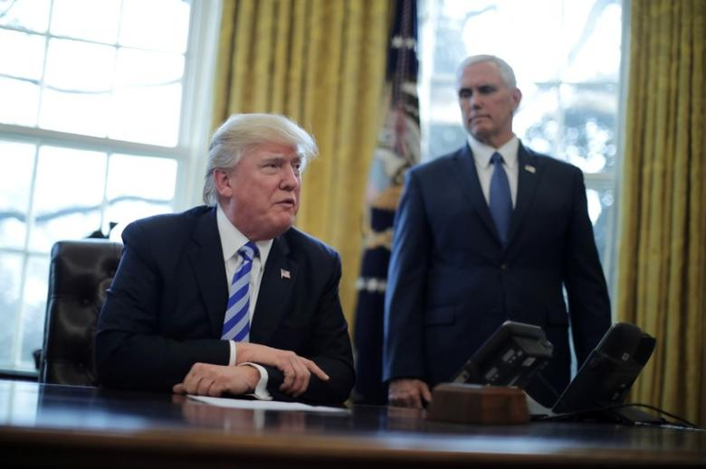 President Trump talks to journalist at the Oval Office of the White House after the AHCA health care bill was pulled before a vote, accompanied by U.S. Health and Human Services Secretary Tom Price (not pictured) and Vice President Mike Pence, in Washington, U.S., March 24, 2017. REUTERS/Carlos Barria