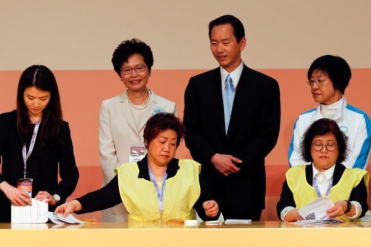 Carrie Lam (2nd L) smiles as officials count votes during the election for Hong Kong's next Chief Executive in Hong Kong, China, March 26, 2017.   REUTERS/Bobby Yip
