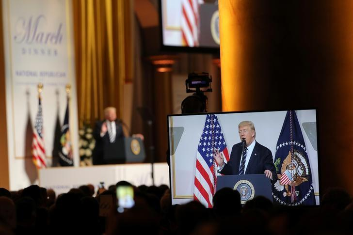 U.S. President Donald Trump delivers remarks at the National Republican Congressional Committee March Dinner in Washington, U.S., March 21, 2017.  REUTERS/Carlos Barria/Files