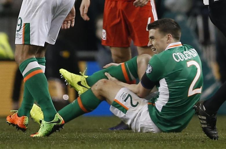 Football Soccer - Republic of Ireland v Wales - 2018 World Cup Qualifying European Zone - Group D - Aviva Stadium, Dublin, Republic of Ireland - 24/3/17 Republic of Ireland's Seamus Coleman lies injured Action Images via Reuters / Matthew Childs Livepic