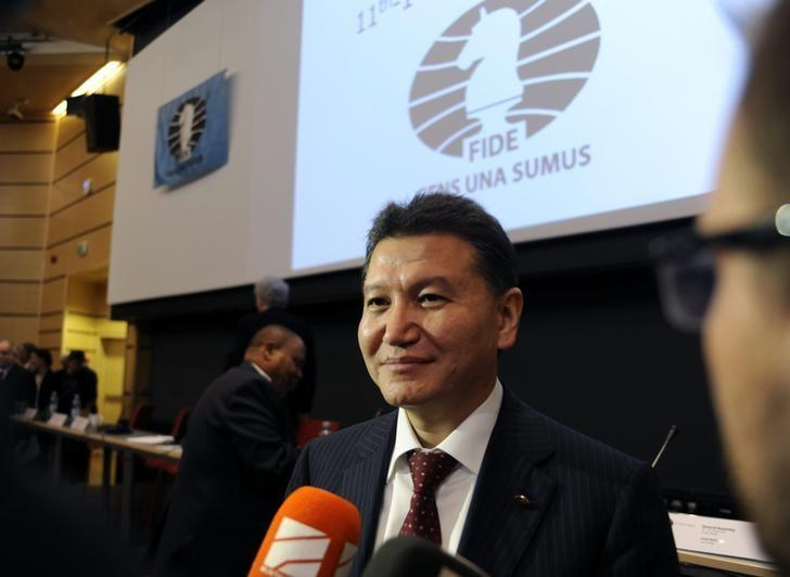 Kirsan Ilyumzhinov smiles after he was re-elected to head the World Chess Federation at the 41st Chess Olympiad in Tromsoe, Norway, August 11, 2014.  REUTERS/Rune Stoltz Bertinussen/NTB Scanpix/Files