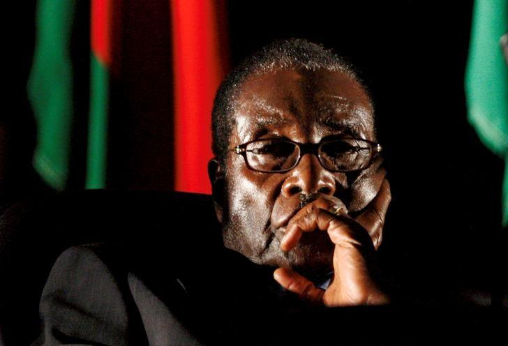 FILE PHOTO -  Zimbabwean President Robert Mugabe watches a video presentation during the summit of the Southern African Development Community (SADC) in Johannesburg, South Africa August 17, 2008. REUTERS/Mike Hutchings/File Photo