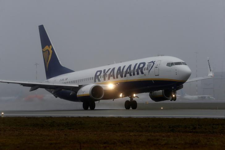 A Ryanair aircraft takes off during a foggy day on Riga International Airport in Riga, Latvia December 21, 2016. REUTERS/Ints Kalnins