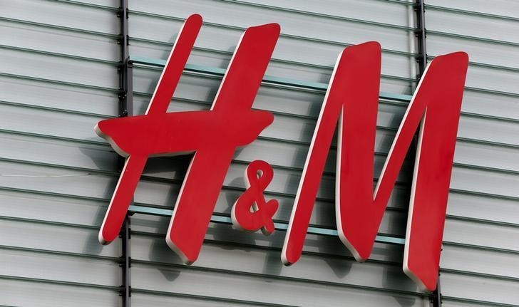 The logo of Swedish fashion retail group H&M is seen at a building in Dietlikon, Switzerland October 11, 2016.  REUTERS/Arnd Wiegmann/Files
