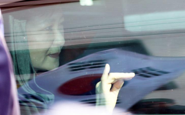 South Korea's ousted leader Park Geun-hye looks out from a vehicle as she leaves her private house in Seoul, South Korea March 30, 2017.Lim Heon-jeong/Yonhap via REUTERS