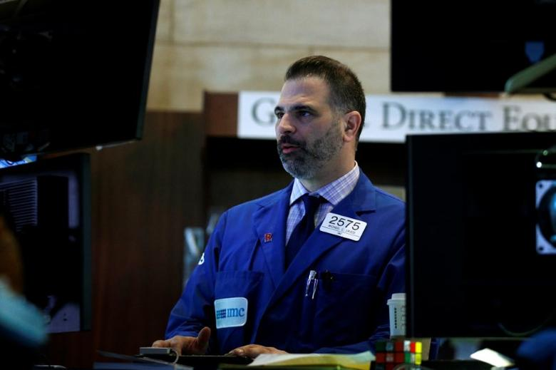 A specialist trader works at his post on the floor of the New York Stock Exchange (NYSE) in New York, U.S., March 30, 2017. REUTERS/Brendan McDermid -