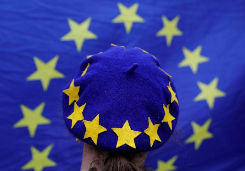 FILE PHOTO: A protester wearing a Europen Union flag themed beret takes part in an anti-Brexit demonstration after Britain's Prime Minister Theresa May triggered the process by which the United Kingdom will leave the Euopean Union, in Birmingham, Britain. REUTERS/Darren Staples
