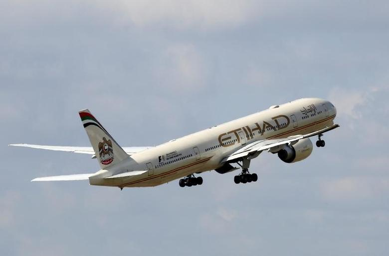 An Etihad Airways Boeing 777-3FX company aircraft takes off at the Charles de Gaulle airport in Roissy, France, August 9, 2016. REUTERS/Jacky Naegelen/Files