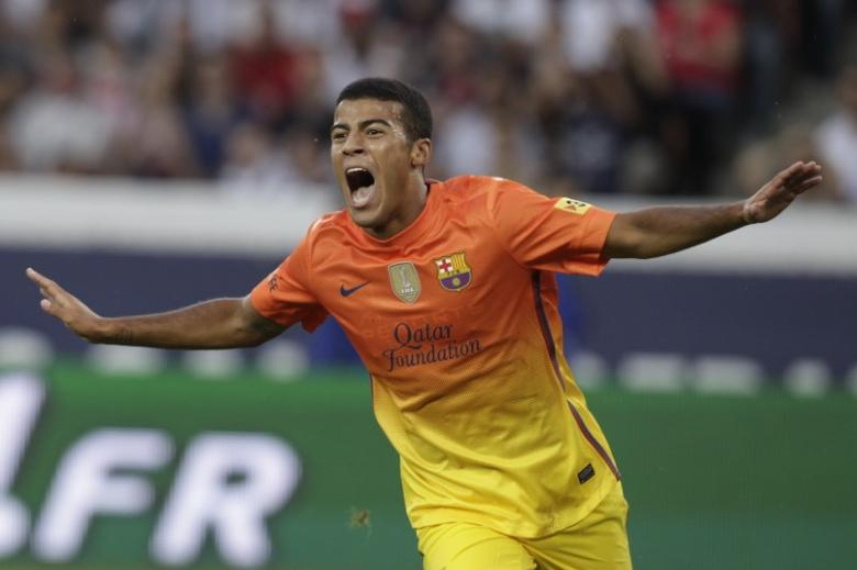 FILE PICTURE: FC Barcelona's Rafinha Alcantara celebrates after scoring against Paris St Germain during their friendly soccer match at Parc des Princes stadium in Paris August 4, 2012. REUTERS/Pascal Rossignol