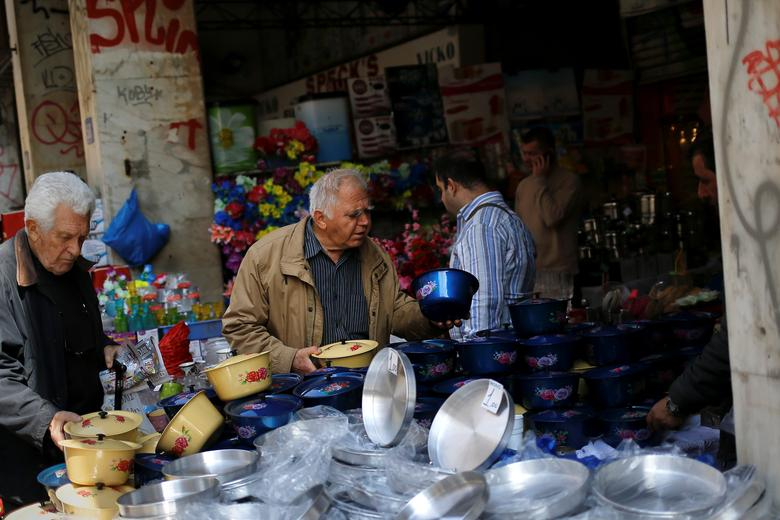 FILE PHOTO: People look at pots on display at a shop in central Athens, Greece, March 22, 2017. REUTERS/Alkis Konstantinidis