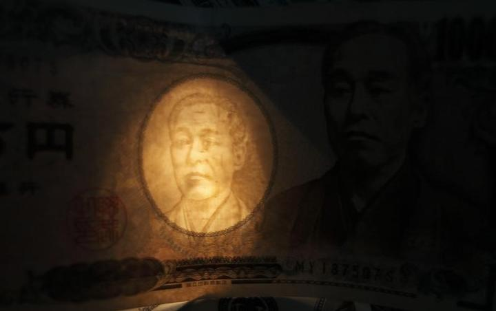 A light is cast through the watermark of a portrait of Yukichi Fukuzawa on...