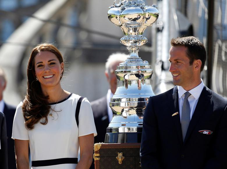 FILE PHOTO: Britain's Catherine, Duchess of Cambridge, wears a Jaeger dress during a photocall with Olympic sailor, Ben Ainslie, at a bid to launch a British Team for the America's Cup, at the National Maritime Museum in London June 10, 2014. REUTERS/Luke MacGregor/File Photo