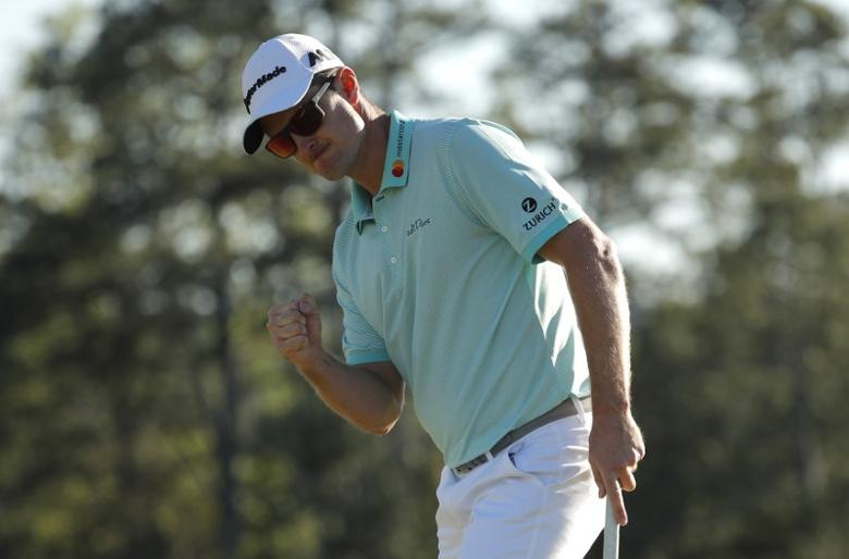 Justin Rose of England celebrates a birdie on the 18th hole in third round play during the 2017 Masters golf tournament at Augusta National Golf Club in Augusta, Georgia, U.S., April 8, 2017. REUTERS/Brian Snyder