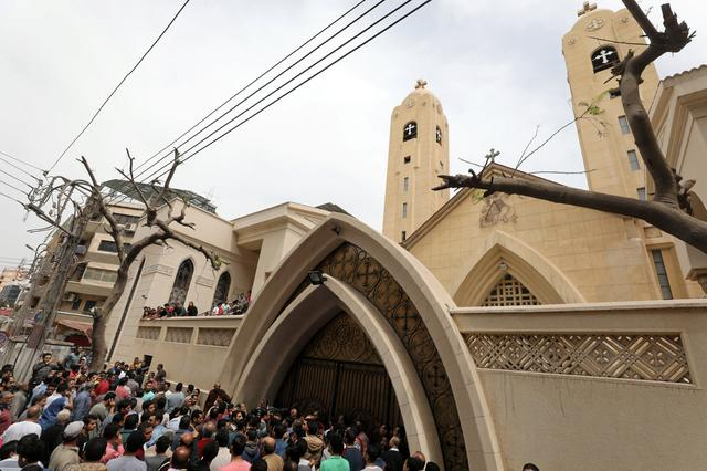 Egyptians gather in front of a Coptic church that was bombed on Sunday in Tanta, Egypt, April 9, 2017.  REUTERS/Mohamed Abd El Ghany