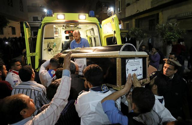 A coffin is carried out of an ambulance outside of the Coptic church that was bombed on Sunday in Tanta, Egypt, April 9, 2017. REUTERS/Mohamed Abd El Ghany