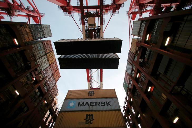 Containers are seen unloaded from the Maersk's Triple-E giant container ship Maersk Majestic, one of the world's largest container ships, at the Yangshan Deep Water Port, part of the  Shanghai Free Trade Zone, in Shanghai, China, September 24, 2016. REUTERS/Aly Song/File Photo