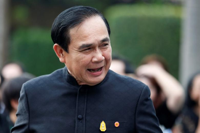 Thailand's Prime Minister Prayuth Chan-ocha smiles as he arrives at a weekly cabinet meeting at the Government House in Bangkok, Thailand, April 4, 2017. REUTERS/Chaiwat Subprasom/Files