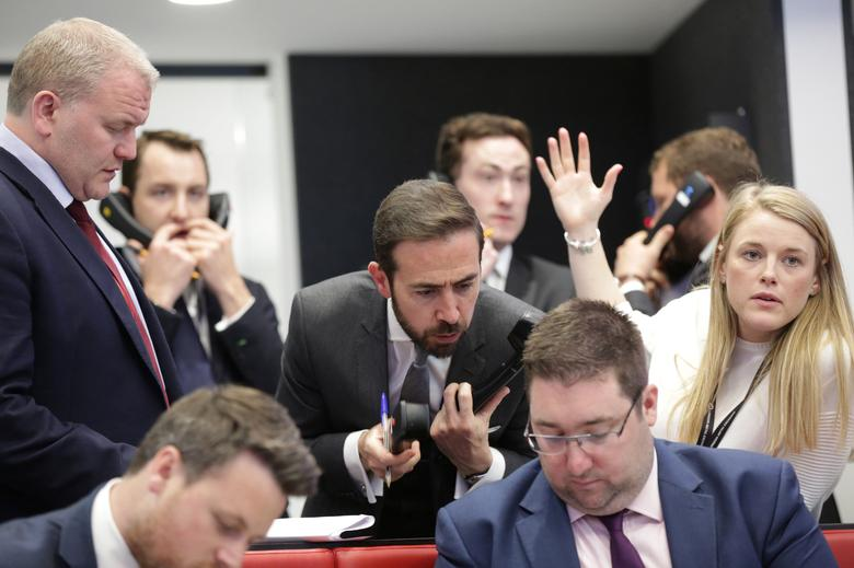 FILE PHOTO: Traders and clerks react on the floor of the London Metal Exchange, London, Britain, May 13, 2016.  REUTERS/Paul Hackett/File Photo