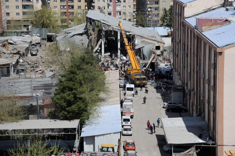 FILE PHOTO : A damaged building is seen after an explosion at a police compound in the southeastern city of  Diyarbakir, Turkey, April 11, 2017. REUTERS/Sertac Kayar/File Photo