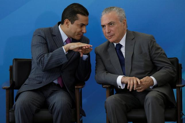 Brazil's Industry and Foreign Trade Minister Marcos Pereira speaks with Brazil's President Michel Temer during a ceremony at the Planalto Palace, in Brasilia, Brazil April 12, 2017. REUTERS/Ueslei Marcelino