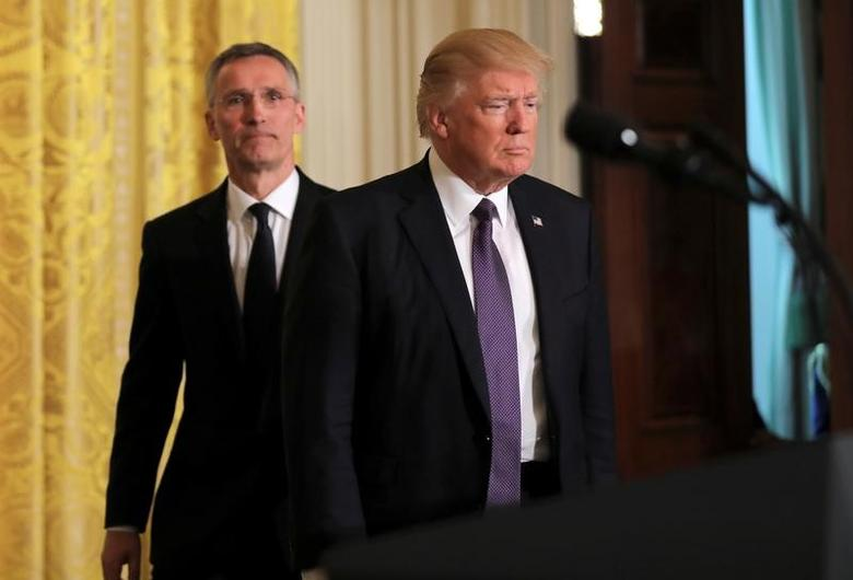 U.S.  President Donald Trump (R) and NATO Secretary General Jens Stoltenberg arrive for a joint news conference in the East Room at the White House in Washington, U.S., April 12, 2017. REUTERS/Carlos Barria