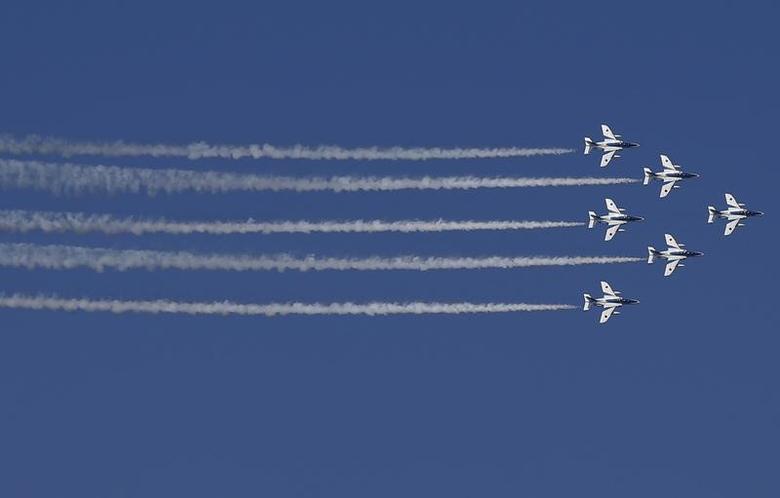 Japan Air Self-Defense Force's (JASDF) aerobatic flight team ''Blue Impulse'' performs during Japan's Maritime Self-Defense Force (JMSDF) fleet review at Sagami Bay, off Yokosuka, south of Tokyo October 18, 2015. REUTERS/Toru Hanai/Files