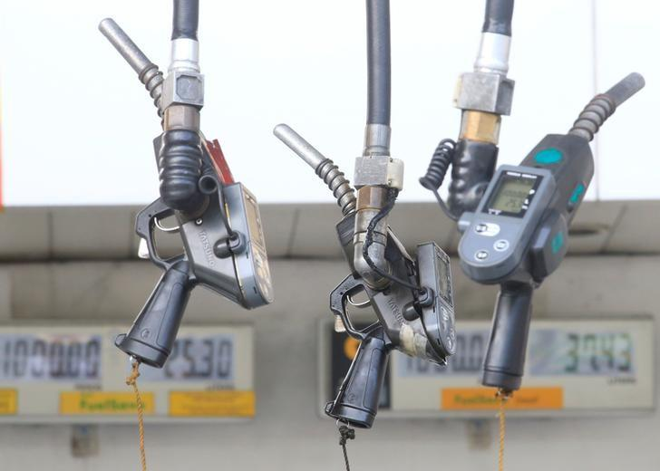 Fuel pumps hang at a gasoline station in Metro Manila, Philippines, August 4, 2016. REUTERS/Romeo Ranoco/Files