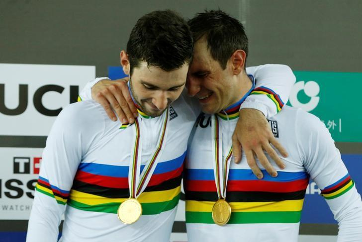 Cycling - UCI Track World Championships - Men's Madison, Final - Hong Kong, China – 16/4/17 - France's Benjamin Thomas (L) and Morgan Kneisky celebrate with their gold medals.  REUTERS/Bobby Yip