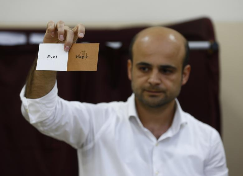 An election official displays a vote as they count at a polling station during a referendum in Izmir, Turkey, April 16, 2017. REUTERS/Osman Orsal