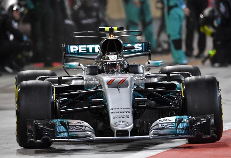 Formula One - F1 - Bahrain Grand Prix - Sakhir, Bahrain - 16/04/17 - Mercedes Formula One driver Valtteri Bottas of Finland leaves the pit lane. REUTERS/Andrej Isakovic/Pool