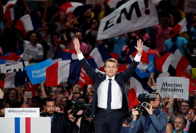 Emmanuel Macron, head of the political movement En Marche !, or Onwards !, and candidate for the 2017 French presidential election, attends a campaign political rally at the AccorHotels Arena in Paris, France, April 17, 2017. REUTERS/Christian Hartmann