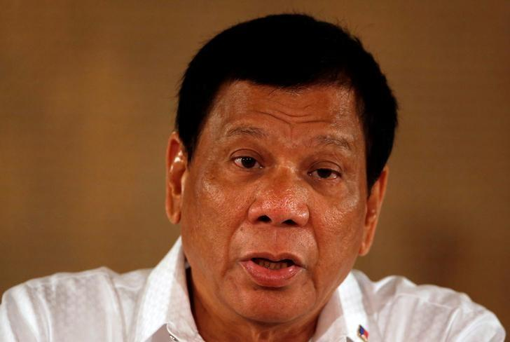 FILE PHOTO: Philippine President Rodrigo Duterte speaks during a news conference at the presidential palace in Manila, Philippines March 13, 2017.   REUTERS/Erik De Castro/File Photo
