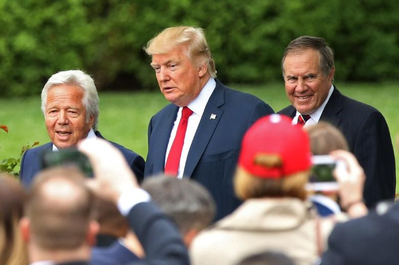Apr 19, 2017; Washington, DC, USA; President Donald Trump (M) walks through Rose Garden with New England Patriots owner Robert Kraft (L) and Patriots head coach Bill Belichick (R) to at a ceremony honoring the Super Bowl LI champion Patriots on the South Lawn at the White House. Mandatory Credit: Geoff Burke-USA TODAY Sports