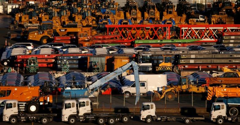 FILE PHOTO: Newly manufactured vehicles await export at a port in Yokohama, Japan, January 16, 2017. Picture taken January 16, 2017.    REUTERS/Toru Hanai/File Photo