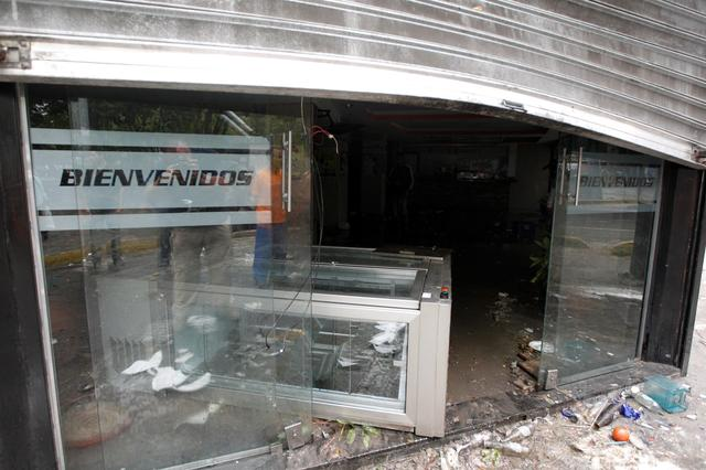 Damage is seen at the entrance of a bakery after it was looted in Caracas, Venezuela April 20, 2017. REUTERS/Christian Veron