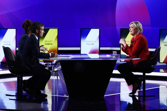 Marine Le Pen (R), French National Front (FN) political party leader and candidate for French 2017 presidential election, attends the France 2 television special prime time political show, ''15min to Convince'' in Saint-Cloud, near Paris, France, April 20, 2017. REUTERS/Martin Bureau/Pool