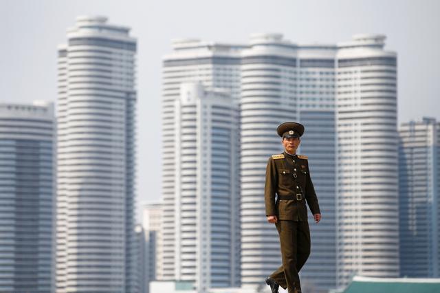 A soldier walks on the bank of the river in central Pyongyang, North Korea April 16, 2017.    REUTERS/Damir Sagolj