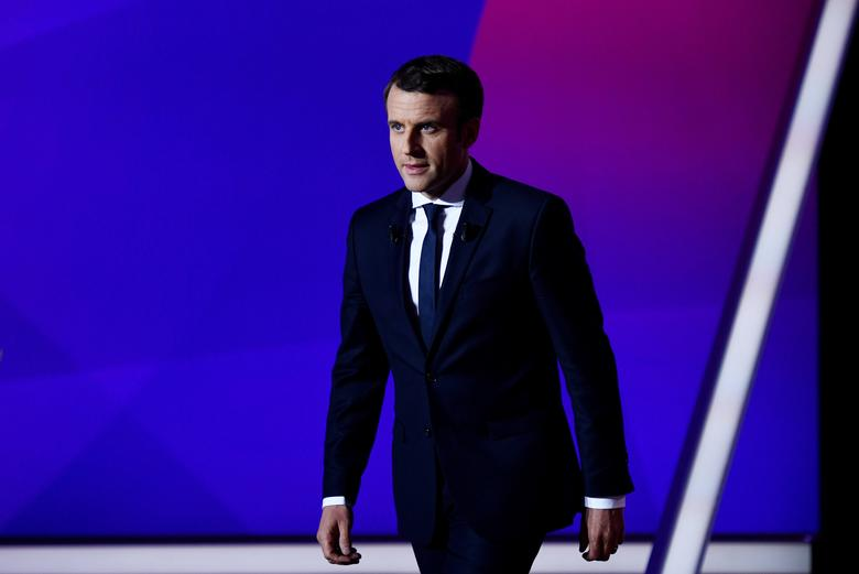 FILE PHOTO: Emmanuel Macron, head of the political movement En Marche!, or Onwards!, and candidate for French 2017 presidential election, attends the France 2 television special prime time political show, ''15min to Convince'' in Saint-Cloud, near Paris, France, April 20, 2017. REUTERS/Martin Bureau/Pool