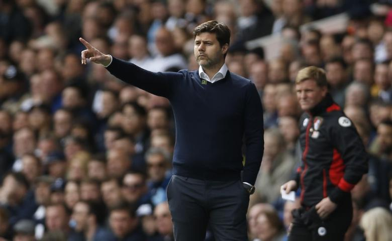 Britain Soccer Football - Tottenham Hotspur v AFC Bournemouth - Premier League - White Hart Lane - 15/4/17 Tottenham manager Mauricio Pochettino and Bournemouth manager Eddie Howe  Action Images via Reuters / Paul Childs