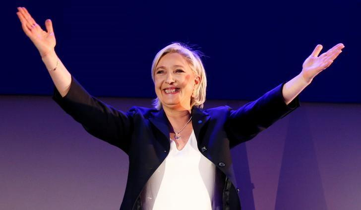 Marine Le Pen, French National Front (FN) political party leader and candidate for French 2017 presidential election, celebrates after early results in the first round of 2017 French presidential election, in Henin-Beaumont, France, April 23, 2017.   REUTERS/Pascal Rossignol