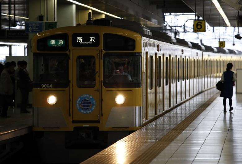 A train of Seibu Railway Co., railway service unit of Seibu Holdings, arrives at a station in Tokyo June 25, 2013. REUTERS/Issei Kato