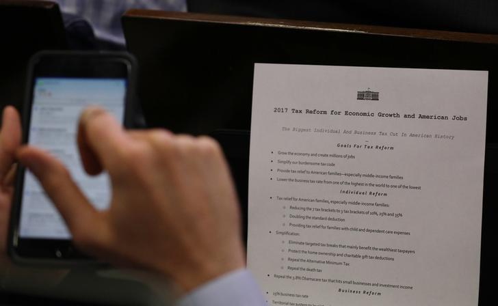 A reporter shoots a picture of a White House press release on its tax reform plan   during the daily briefing at the White House in Washington, U.S., April 26, 2017. REUTERS/Carlos Barria