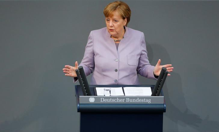 German Chancellor Angela Merkel addresses the lower house of parliament Bundestag in Berlin, Germany, April 27, 2017.      REUTERS/Hannibal Hanschke
