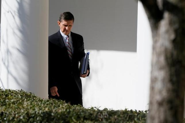 FILE PHOTO: White House National Security Advisor Michael Flynn walks down the White House colonnade on the way to Japanese Prime Minister Shinzo Abe and U.S. President Donald Trump's joint news conference at the White House in Washington, U.S. on February 10, 2017.  REUTERS/Jim Bourg/Files