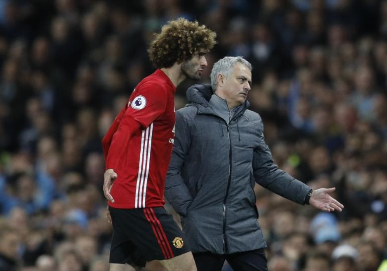 Britain Soccer Football - Manchester City v Manchester United - Premier League - Etihad Stadium - 27/4/17 Manchester United's Marouane Fellaini after being sent off with manager Jose Mourinho  Reuters / Darren Staples Livepic EDITORIAL USE ONLY. No use with unauthorized audio, video, data, fixture lists, club/league logos or ''live'' services. Online in-match use limited to 45 images, no video emulation. No use in betting, games or single club/league/player publications.  Please contact your account representative for further details.